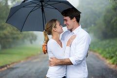 Couple umbrella rain Royalty Free Stock Images