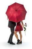 Couple and Umbrella Stock Photography