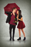 Couple and Umbrella Stock Image