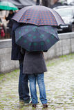 Couple with umbrellas Stock Photo