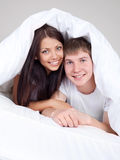 Couple under the blanket Stock Images