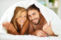 Couple under blanket Royalty Free Stock Photography