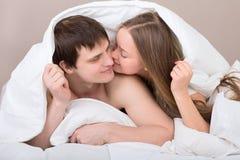 Couple under blanket Royalty Free Stock Photo