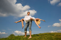 Couple under blue sky Stock Photos
