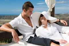 Couple under the blue sky on a bed Royalty Free Stock Images