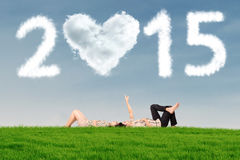 Couple under cloud 2015 Stock Photography