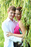 Couple under green willow Royalty Free Stock Photo