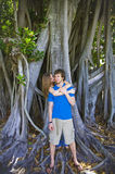 Couple under old tree. Close up of teenage couple embracing under old tree Royalty Free Stock Photos