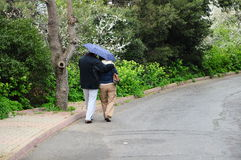 Couple under rain Stock Photo