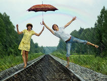 Couple under rain Royalty Free Stock Images