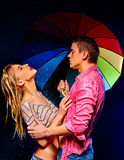 Couple  under  rain with umbrella Royalty Free Stock Images