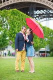 Couple under red umbrella Royalty Free Stock Images