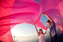 Couple under the sail Royalty Free Stock Images