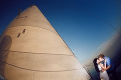 Couple under the sail Royalty Free Stock Photography