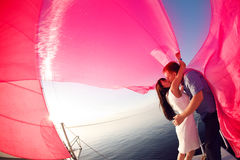 Couple under the sail Royalty Free Stock Photo