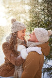 Couple under snowfall Royalty Free Stock Photography