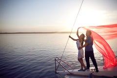 Couple Under The Sail Stock Photos