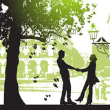 Couple Under The Tree In City Park Stock Images
