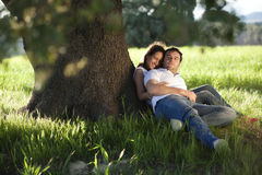 Couple under tree Royalty Free Stock Photos