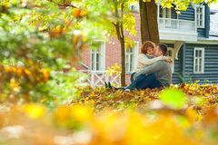 Couple under the tree. Romentic couple under the tree in autumn park royalty free stock image