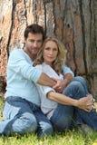 Couple under a tree Stock Photo