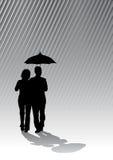 Couple under umbrella Stock Images