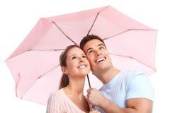 Couple under umbrella stock image