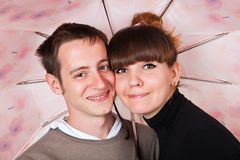 A couple under an umbrella Royalty Free Stock Images