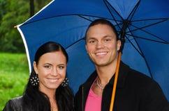 Couple under umbrella Stock Photo