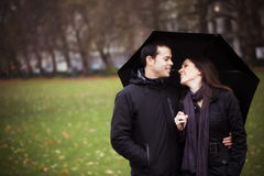 Couple under umbrella Stock Image