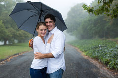 Couple under an umbrella Stock Image