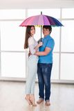 Couple under a umbrella Stock Photos