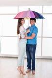 Couple under a umbrella Stock Photos