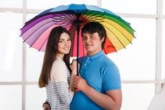 Couple under a umbrella Stock Photo