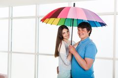 Couple under a umbrella Stock Photo