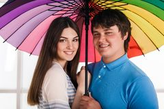 Couple under a umbrella Royalty Free Stock Photos