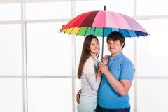 Couple under a umbrella Stock Images