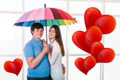 Couple under a umbrella Royalty Free Stock Images