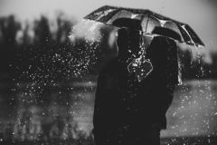 Couple under an umbrella in the rain royalty free stock photos