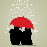 Couple under umbrella on rainy background. Royalty Free Stock Photo