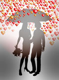 Couple under umbrella Stock Images