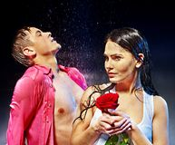 Couple  under  water drop. Stock Photos