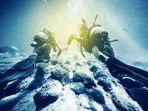 Couple of underwater divers. Stock Photos