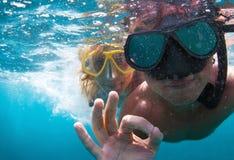 Couple underwater Stock Photography