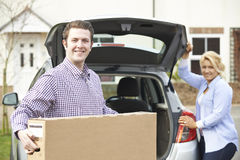 Couple Unloading New Television From Car Trunk Stock Photography