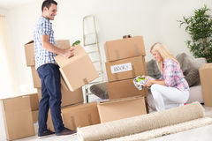 Couple unpack moving boxes. stock images