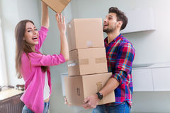 Couple with unpacked boxes in new home Stock Photo