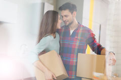 Couple with unpacked boxes in new home Stock Images