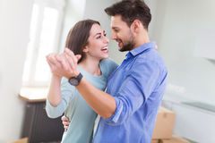 Couple with unpacked boxes in new home Royalty Free Stock Image