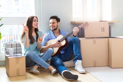 Couple with unpacked boxes in new home Stock Photography